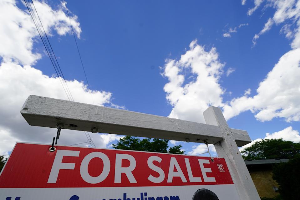 'For Sale' sign is pictured in the front yard of a house in Toronto, Ontario, Canada, July 17, 2018. Picture taken July 17, 2018. REUTERS/Carlo Allegri