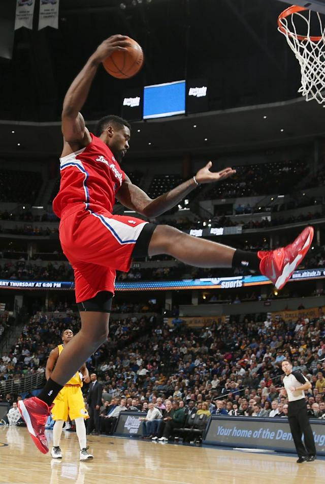 Los Angeles Clippers center DeAndre Jordan pulls down rebound against the Denver Nuggets in the fourth quarter of the Nuggets' 116-115 victory in an NBA basketball game in Denver, Monday, Feb. 3, 2014. (AP Photo/David Zalubowski)
