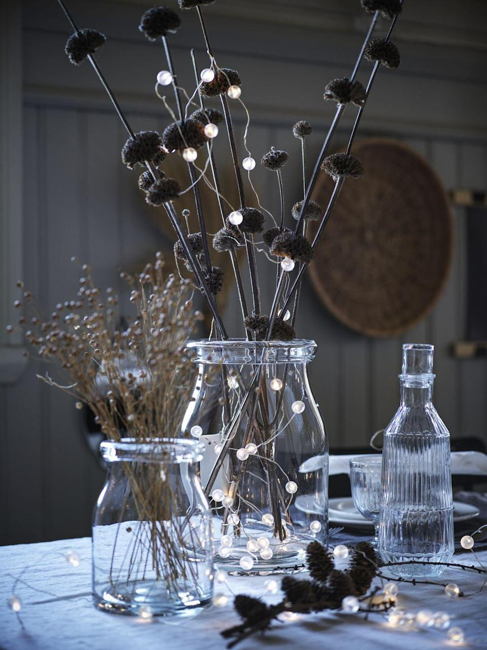 """<p>Create a warm glow this <a href=""""https://www.countryliving.com/uk/homes-interiors/interiors/g22198694/john-lewis-christmas-decoration-trends/"""" rel=""""nofollow noopener"""" target=""""_blank"""" data-ylk=""""slk:Christmas"""" class=""""link rapid-noclick-resp"""">Christmas</a> with IKEA's range of twinkling lights, twig trees and glass vases. </p><p>""""As we look forward to hosting friends and family again, it's a wonderful opportunity to embrace the Swedish concept of Mys ['mees'], focusing on slowing down and cosiness,"""" Rosheen says. </p><p>""""The Scandinavian tradition takes place during the longer and darker winter months, encouraging all to embrace home comforts and step away from the outside world.""""</p>"""
