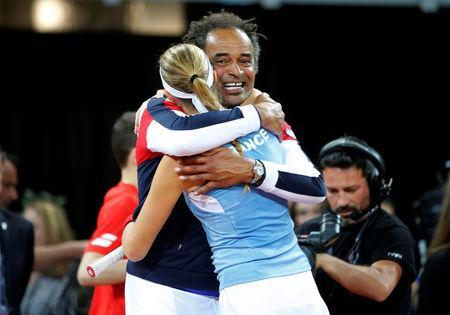 Tennis - Fed Cup - World Group Semi Final - France vs United States - Arena Du Pays D'Aix, Aix-en-Provence, France - April 21, 2018 France's Kristina Mladenovic celebrates with France captain Yannick Noah after winning her match against CoCo Vandeweghe of the U.S. REUTERS/Jean-Paul Pelissier