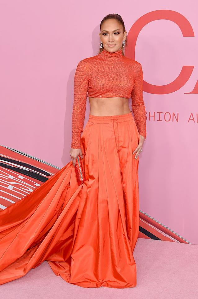 <p>At the 2019 CFDA Fashion Awards, Lopez showed up in this  Ralph Lauren crop top and skirt from the American designer's Fall 1999 collection. </p>