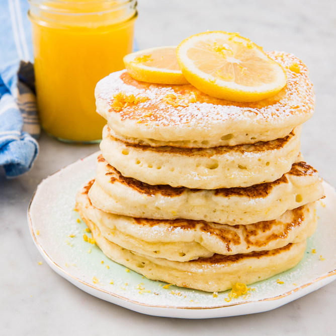 """<p>Perfectly tart with a hint of sweetness, these are the absolute-best lemon ricotta pancakes.</p><p>Get the <a href=""""https://www.delish.com/uk/cooking/recipes/a34725455/ricotta-pancakes-recipe/"""" rel=""""nofollow noopener"""" target=""""_blank"""" data-ylk=""""slk:Lemon Ricotta Pancakes"""" class=""""link rapid-noclick-resp"""">Lemon Ricotta Pancakes</a> recipe.</p>"""