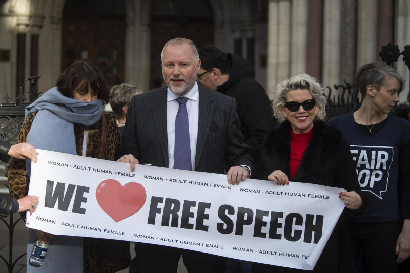 "Former police officer Harry Miller with supporters outside the High Court, London, ahead of the ruling that his allegedly ""transphobic"" tweets were lawful and Humberside Police's response interfered with his right to freedom of expression."