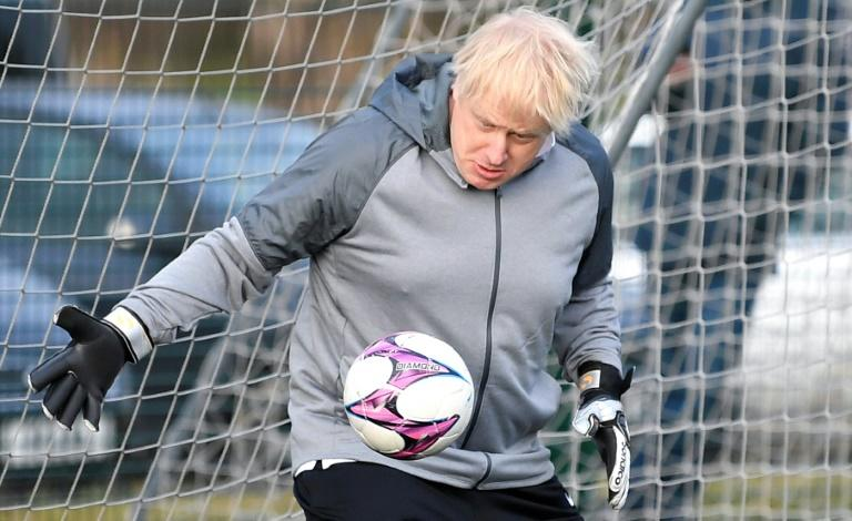 Prime Minister Boris Johnson is hoping to regain the majority his Conservative Party lost in 2019, with latest polls suggesting he is narrowly on course to achieve his goal (AFP Photo/TOBY MELVILLE)