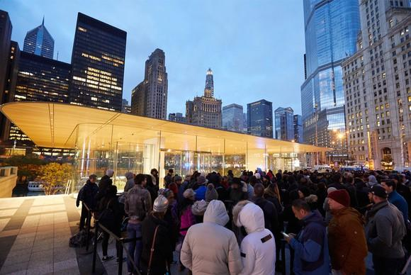 Apple customers waiting in line at an Apple Store in Michigan on the iPhone X launch day