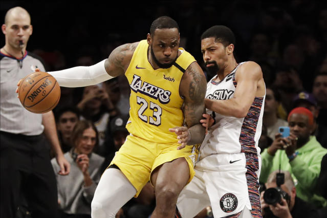 Brooklyn Nets' Spencer Dinwiddie defends Los Angeles Lakers' LeBron James (23) during the second half of an NBA basketball game Thursday, Jan. 23, 2020, in New York. The Lakers won 128-113. (AP Photo/Frank Franklin II)