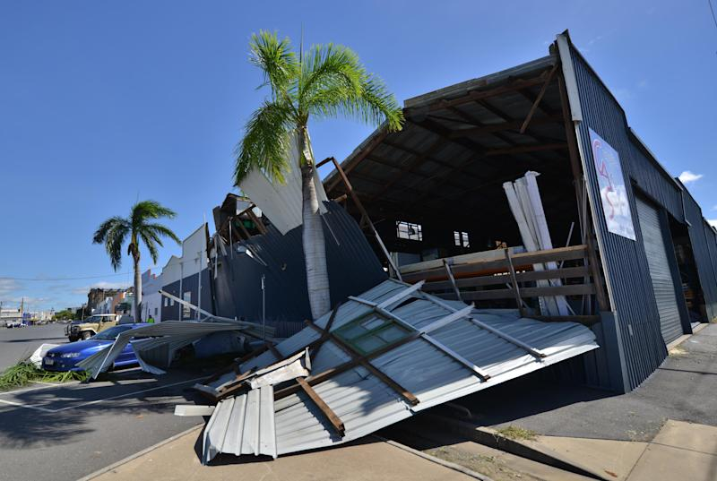 A cyclone-damaged business is seen in the northern Queensland town of Rockhampton on February 21, 2015 (AFP Photo/Peter Parks)