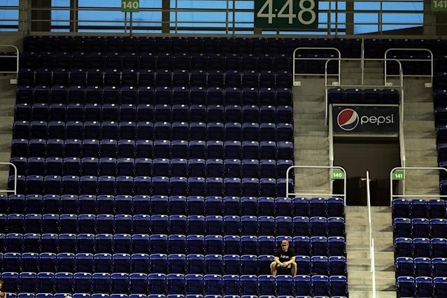 MIAMI, FL - APRIL 16: A fan in the upper deck as the Miami Marlins play a game against the Washington Nationals at Marlins Park on April 16, 2013 in Miami, Florida. The Marlins defeated the Nationals 8-2. (Photo by Marc Serota/Getty Images)