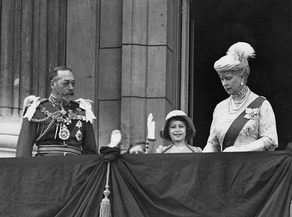 <p>Princesses Elizabeth and Margaret wave from the balcony with King George V and Queen Mary. Also this year, Prince Henry (son of George V and Queen Mary) marries Lady Alice Montagu Douglas Scott, and King George V's sister, Princess Victoria, dies.</p>