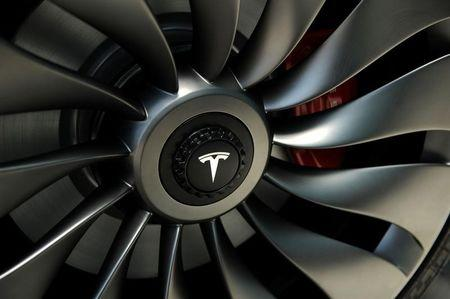 FILE PHOTO: A wheel of a  prototype of the Tesla Model 3 on display in front of the factory in Sparks
