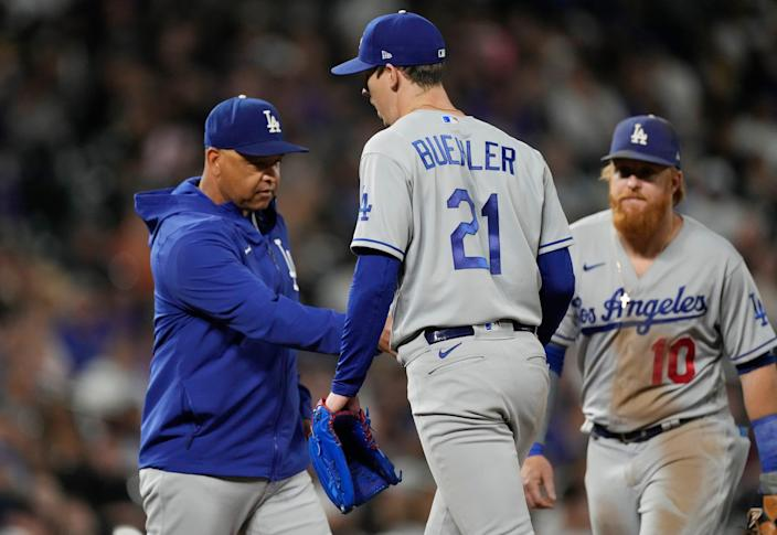 Manager Dave Roberts takes the ball from Walker Buehler during the Dodgers' loss to the Rockies on Wednesday.