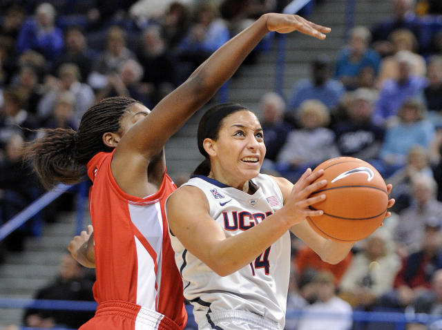 Connecticut guard Bria Hartley (14) drives to the basket while being guarded by Hartford forward La'Trice Hall during the first half of an NCAA college basketball game in Hartford, Conn., on Saturday, Nov. 9, 2013. (AP Photo/Fred Beckham)