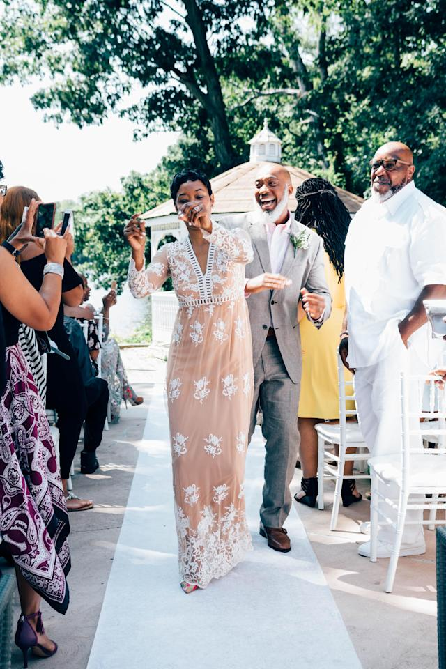 Anthony and Dajuana Mayers cheerfully walking down the aisle at their vow renewal ceremony. (Photo: Catherine Rogers)
