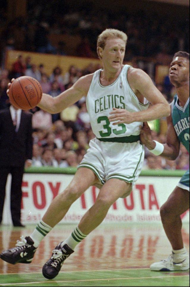 In this November 1991 file photo, Boston Celtics star Larry Bird during a game at the Boston Garden, in Boston. (AP Photo/Charles Krupa)