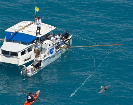 Diana Nyad, positioned about than two miles off Key West, Florida in this September 2, 2013 handout photo, swims towards the completion of her 111-mile trek from Cuba to the Florida Keys. REUTERS/Andy Newman/Florida Keys News Bureau/Handout via Reuters