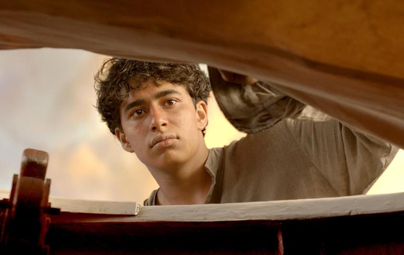 """This film image released by 20th Century Fox shows Suraj Sharma as Pi Patel in a scene from """"Life of Pi."""" (AP Photo/20th Century Fox)"""