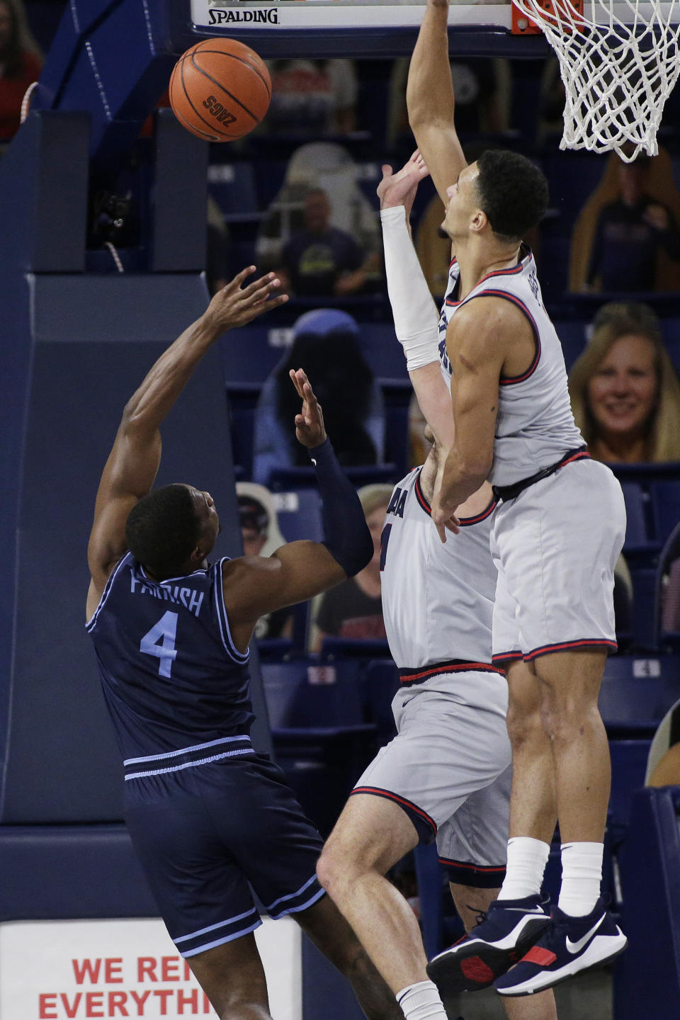 San Diego forward Josh Parrish, left, shoots while pressured by Gonzaga guard Jalen Suggs, right, and forward Corey Kispert during the first half of an NCAA college basketball game in Spokane, Wash., Saturday, Feb. 20, 2021. (AP Photo/Young Kwak)
