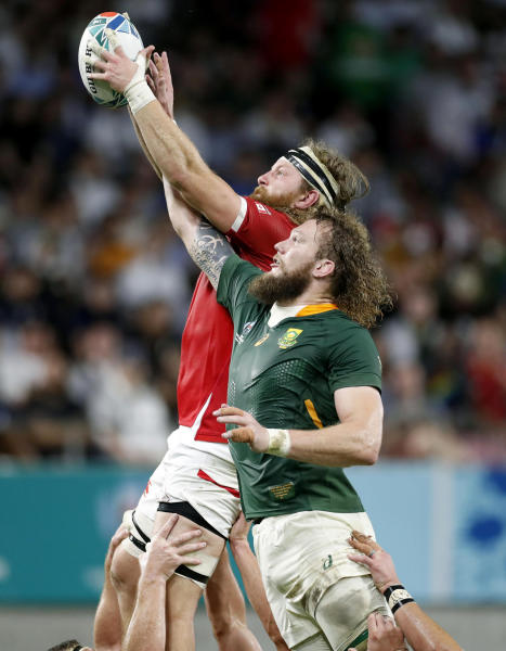 Canada's Evan Olmstead and South Africa's RG Snyman compete for lineout ball during the Rugby World Cup Pool B game at Kobe Misaki Stadium between South Africa and Canada in Kobe, Japan, Tuesday, Oct. 8, 2019. (Kyodo News via AP)