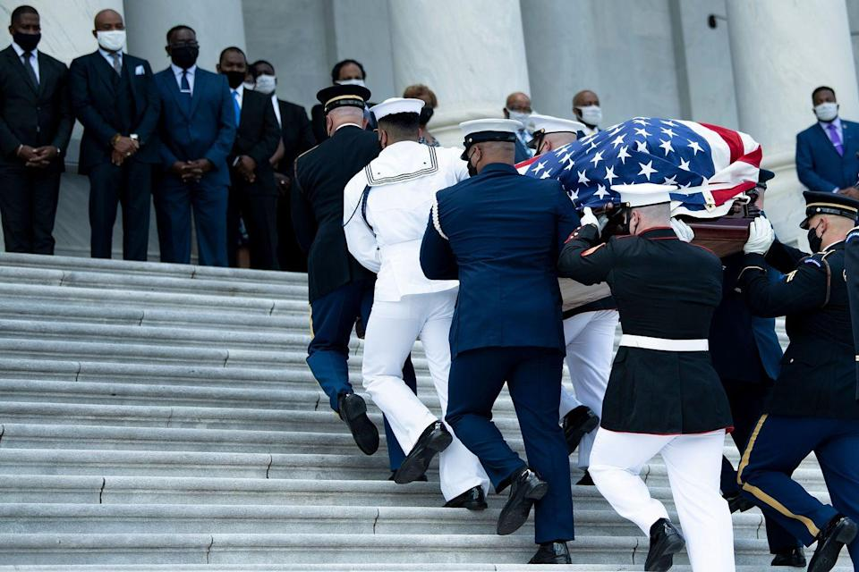 <p>Loved ones watch as the flag-draped casket of US congressman and civil rights icon John Lewis is carried by a joint services military honor guard to lie in state at the US Capitol in Washington, DC July 27, 2020.</p>
