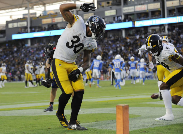 Oct 13, 2019; Carson, CA, USA; Pittsburgh Steelers running back James Conner (30) celebrates with wide receiver JuJu Smith-Schuster (19) his touchdown scored against the Los Angeles Chargers during the first half at Dignity Health Sports Park. (USA TODAY Sports)