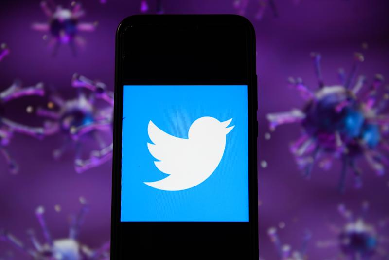 In this photo illustration a Twitter logo displayed on a...