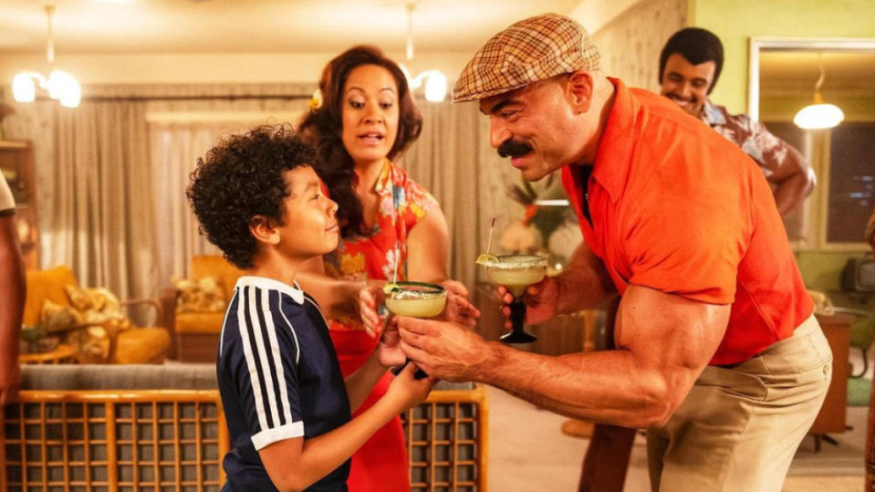 Brett Azar as The Iron Sheik and Adrian Groulx as Dwayne Johnson in 'Young Rock'. (Credit: Dwayne Johnson/Instagram/NBC)