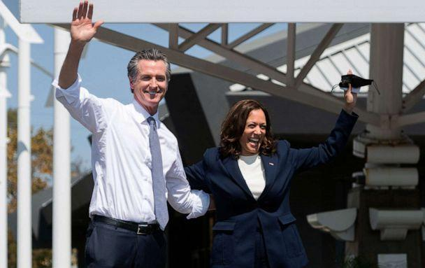 PHOTO: Vice President Kamala Harris waves alongside California Governor Gavin Newsom during a campaign event against his recall election at the IBEW-NECA Joint Apprenticeship Training Center in San Leandro, Calif., Sept. 8, 2021. (Saul Loeb/AFP via Getty Images)