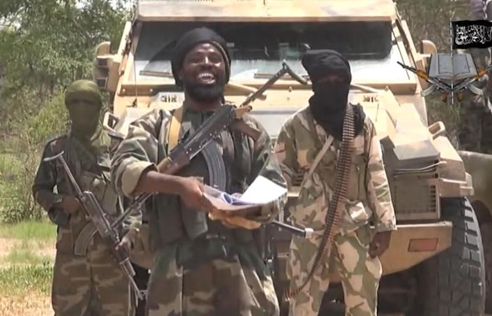 A screengrab taken on July 13, 2014 from a video released by the Nigerian Islamist extremist group Boko Haram and obtained by AFP shows the leader of the Nigerian Islamist extremist group Boko Haram, Abubakar Shekau (centre) (AFP Photo/Ho)