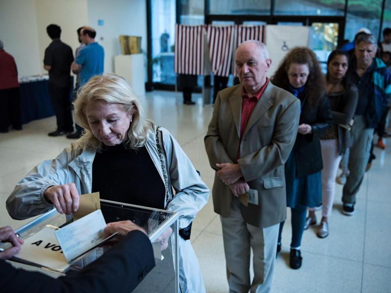 A French citizen casts her ballot at the French embassy in Washington DC: Getty Images