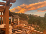 This Friday, Oct. 16, 2020, photo courtesy of Brian DeToy shows the home deck of Brian DeToy and his wife, Sheryl Shafer in Boulder, Colo. Orange skies, winds gusting up to 70 mph, smoke tornadoes and hazardous air. While it could be an apocalyptic scene out of a movie, it's become the reality of Colorado's wildfire season. (Brian DeToy via AP)