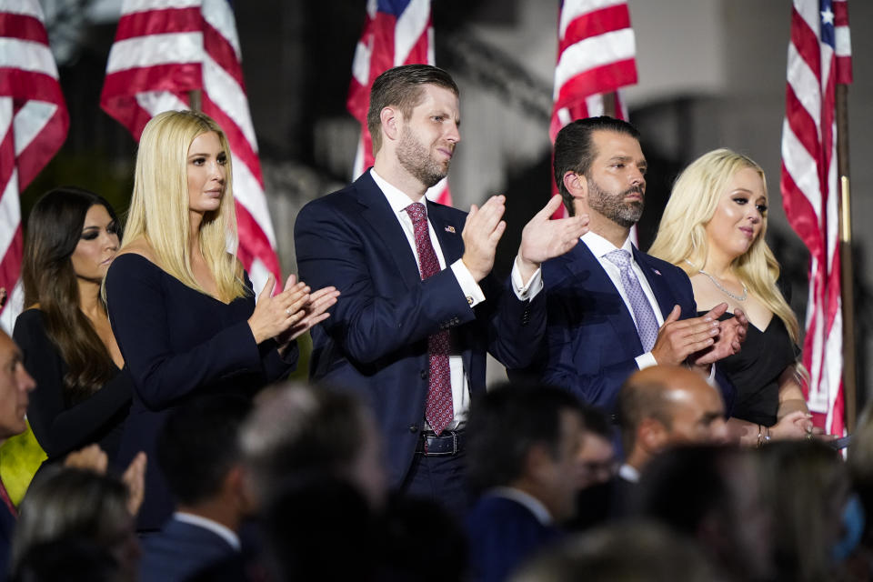 Ivanka Trump, Eric Trump, Donald Trump Jr. and Tiffany Trump stand and applaud