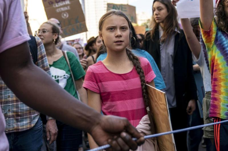 Greta Thunberg (center) at a climate change rally in New York City in September. | Drew Angerer/Getty