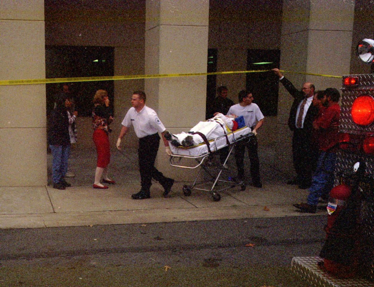 <p>Wounded student is rushed to an ambulance after the shooting. (Photo: Barkley Thieleman/The Paducah Sun/AP) </p>