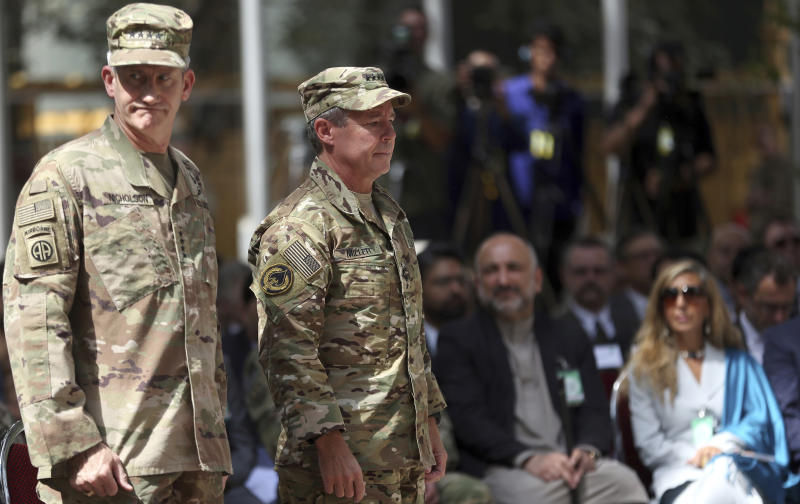 Outgoing U.S. Army Gen. John Nicholson, left, and incoming U.S. Army Gen. Austin Miller, second from left, prepare for the change of command ceremony at Resolute Support headquarters in Kabul, Afghanistan, Sunday, Sept. 2, 2018. Miller has assumed command of the 41-nation NATO mission in Afghanistan following a handover ceremony. (AP Photo/Massoud Hossaini)