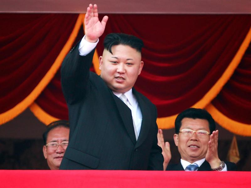 North Korean leader Kim Jong-un waves from a balcony during a parade for the 'Day of the Sun' festival in Pyongyang on Saturday (EPA)