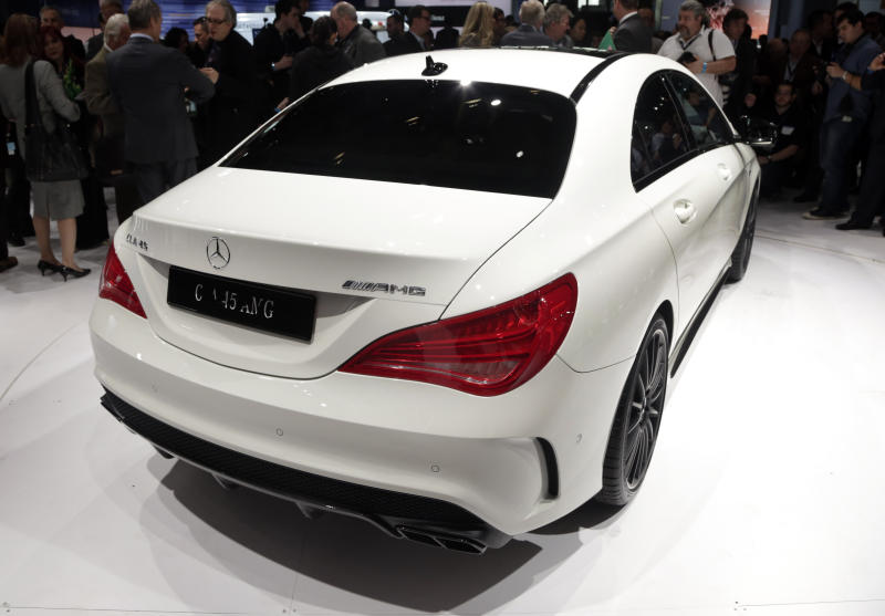 FILE - In this March 27, 2013 file photo, the 2014 CLA 45 AMG Mercedes-Benz is presented at the New York International Auto Show, in the Javits Center, in New York. The CLA 45 AMG all-wheel-drive with 355 horses goes on sale in November. (AP Photo/Richard Drew, File)