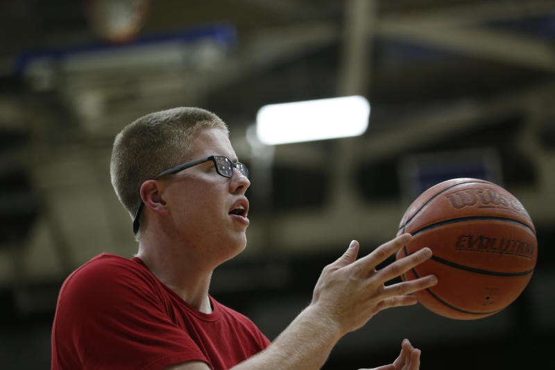 17 AUG 2016: Josh Speidel shoot hoops with his friends Gabe Holt, St. Francis Brooklyn basketball player (in GREY Shirt), Christian Glass, Xavier baseball player (whit shirt, black shorts) and Elliott Welmer, St. Louis basketball player (Blue shorts) in his high school gym in Columbus, Ind.. AJ Mast/ NCAA Photos via Getty Images