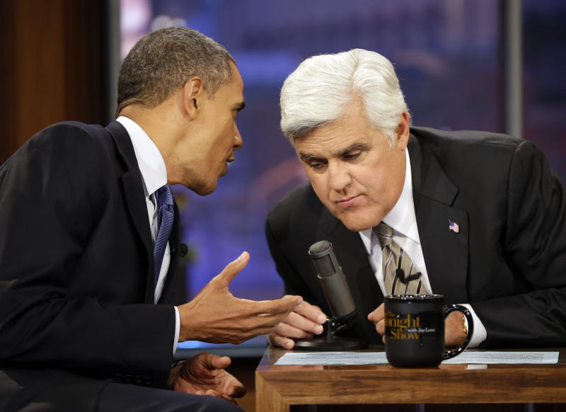 President Barack Obama, right, talks with Jay Leno, right, during a commercial break during the taping of his appearance on NBC's The Tonight Show with Jay Leno, Wednesday, Oct. 24, 2012, in Burbank, Calif. (AP Photo/Pablo Martinez Monsivais)