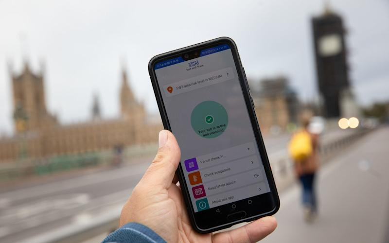 A smartphone displays a screen from the contract tracing app - Simon Dawson/Bloomberg