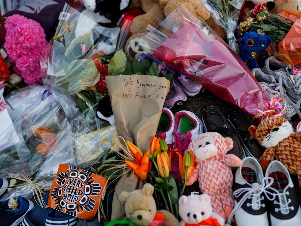 A makeshift memorial at the former Kamloops Indian Residential School in early June to honour children whose remains have been discovered buried near the facility (AFP via Getty Images)