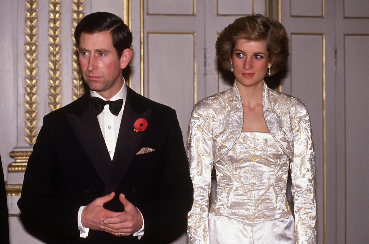 PARIS - NOVEMBER:  Prince Charles and Diana Princess of Wales meet guests arriving at a dinner in the Elysee Palace in Paris, France in November 1988, during the Royal Tour of France. Diana wore a dress designed by Victor Edelstein.(Photo by David Levenson/Getty Images)
