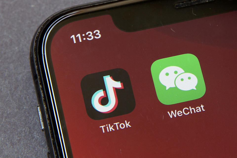 FILE - A federal judge has approved a request from a group of WeChat users to delay looming U.S. government restrictions that could effectively make the popular app nearly impossible to use. In a ruling dated Saturday, Sept. 19, 2020, Magistrate Judge Laurel Beeler in California said the government's actions would affect users' First Amendment rights as an effective ban on the app removes their platform for communication. (AP Photo/Mark Schiefelbein, File)