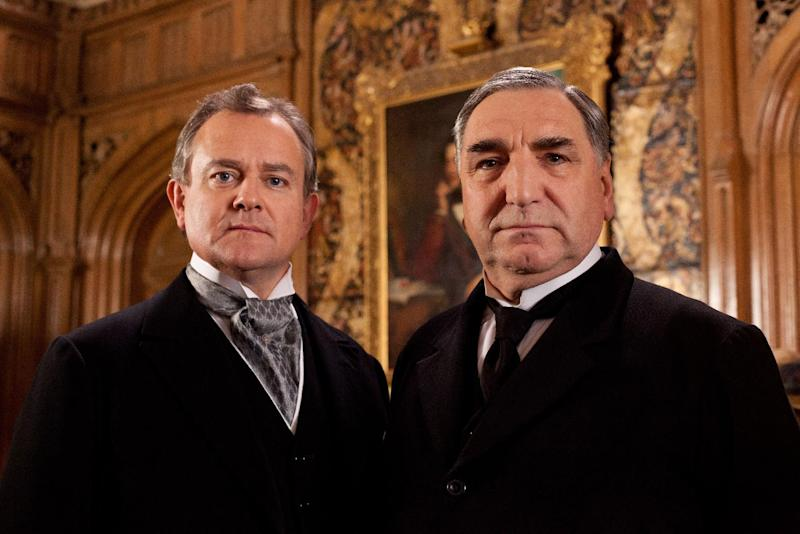 """FILE - This undated file publicity image provided by PBS shows Hugh Bonneville as Lord Grantham, left, and Jim Carter as Mr. Carson from the popular series """"Downton Abbey."""" The fourth season of """"Downton Abbey"""" will debut Sunday, Jan 5, 2014. (AP Photo/PBS, Josh Barratt)"""
