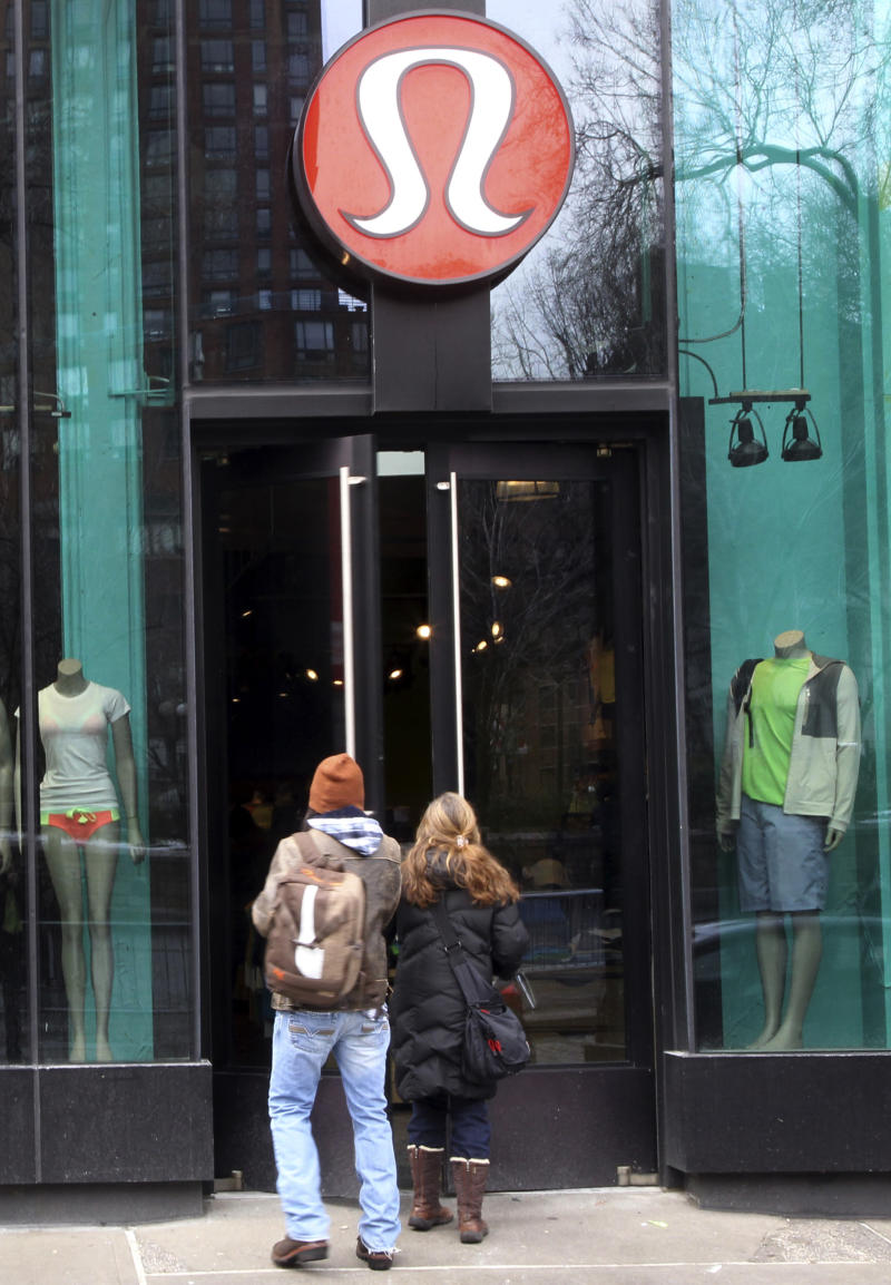 Shoppers enter the Lululemon Athletica store  Tuesday, March 19, 2013 at Union Square in New York. Lululemon has yanked its popular black yoga pants from store shelves after it found that the sheer material used was revealing too much of its loyal customers. (AP Photo/Mary Altaffer)