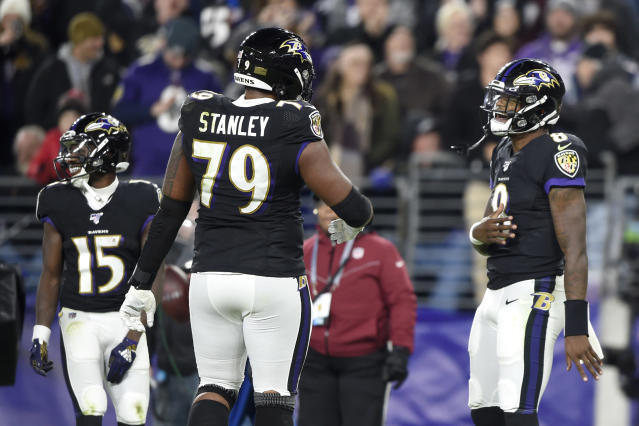 Lamar has plenty of reasons to be thankful for left tackle Ronnie Stanley. (AP Photo/Gail Burton)