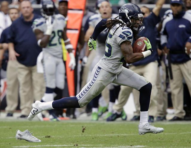 Seattle Seahawks' Richard Sherman loses his shoe as he returns an interception for a touchdown during the fourth quarter an NFL football game against the Houston Texans, Sunday, Sept. 29, 2013, in Houston. (AP Photo/Patric Schneider)