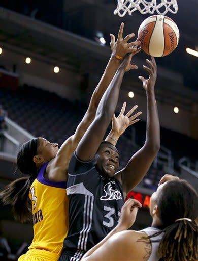 San Antonio Silver Stars' Sophia Young, center, and Los Angeles Sparks' Candace Parker reach for a rebound during Game 1 of a WNBA basketball first-round playoff series, in Los Angeles on Thursday, Sept. 27, 2012. (AP Photo/Jae C. Hong)