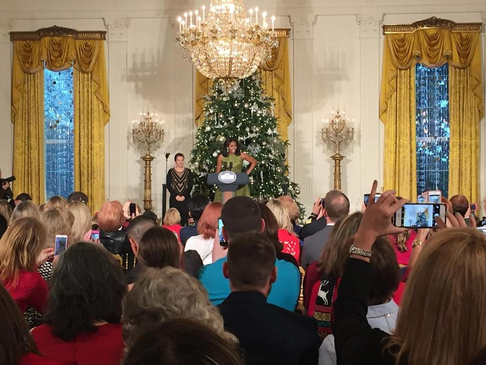 <p>First Lady Michelle Obama addresses family of military members in the East Room ahead of unveiling this year's holiday decorations.<i> (Photo: Cassie Carothers)</i></p>