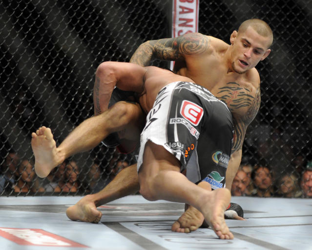 Dustin Poirier, right, of Coconut Creek, Fla., and Diego Brandao, of Brazil, grapple during a UFC 168 mixed martial arts featherweight bout on Saturday, Dec. 28, 2013, in Las Vegas. Poirer won by a technical knockout in the first round. (AP Photo/David Becker)