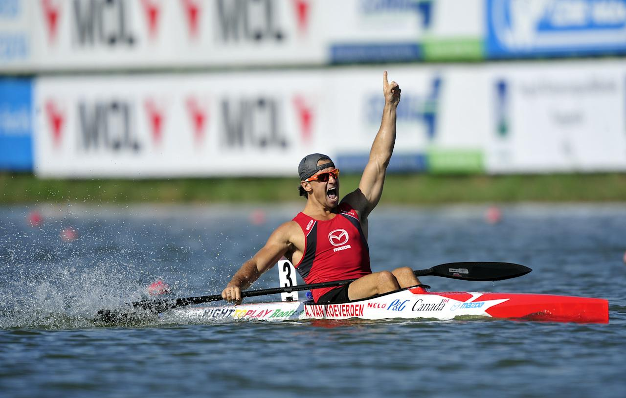 Canada's Adam van Koeverden celebrates his victory at the finish line of men's K1 1000m final of the 39th ICF Flatwater world championships at the Matyeri Lake of Szeged on August 19, 2011. AFP PHOTO / ATTILA KISBENEDEK (Photo credit should read ATTILA KISBENEDEK/AFP/Getty Images)